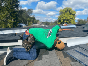 Professional roofer patching a leak on a roof